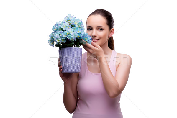 Young woman with flower pot isolated on white Stock photo © Elnur