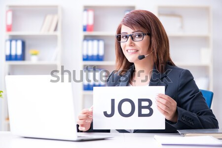 Businesswoman working at her desk on white background Stock photo © Elnur