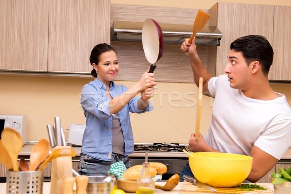 Jovem família engraçado lutar cozinha comida Foto stock © Elnur