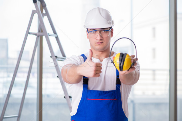 Stock photo: Young worker with noise cancelling headphones