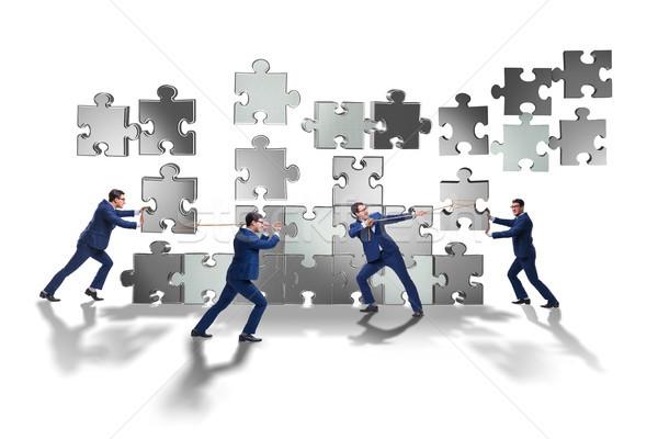 üzlet csapatmunka kirakó darabok férfi háború csoport Stock fotó © Elnur