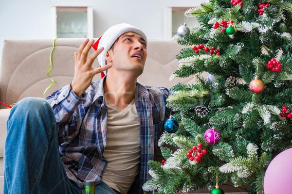 Człowiek kac christmas strony szkła zabawy Zdjęcia stock © Elnur