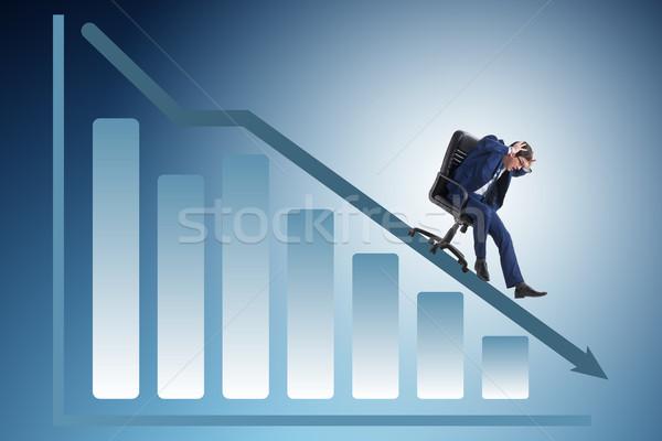 Empresário para baixo cadeira econômico crise homem Foto stock © Elnur