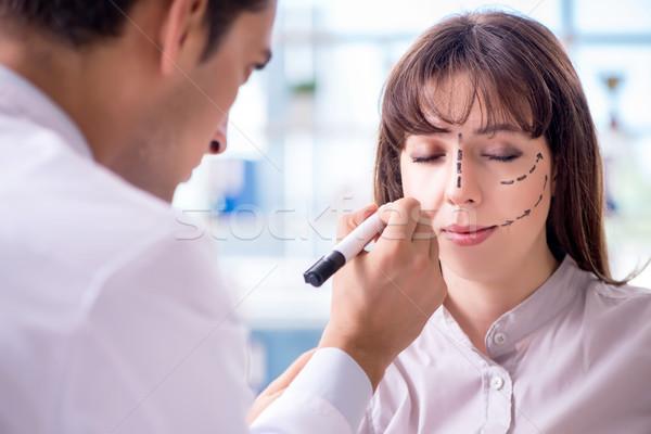 Plastic surgeon preparing for operation on woman face Stock photo © Elnur