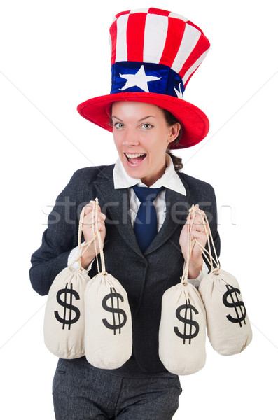 Businesswoman with sacks of money on white Stock photo © Elnur