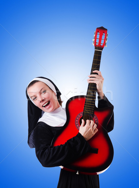 Nun playing guitar against the gradient  Stock photo © Elnur