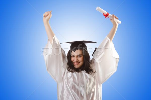 Diplômé diplôme blanche sourire étudiant succès Photo stock © Elnur