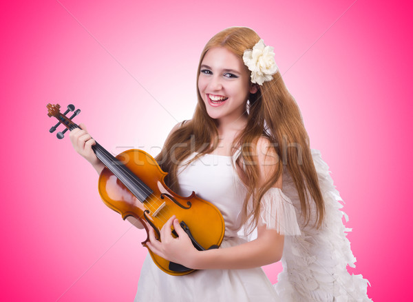 Young violin player isolated on white Stock photo © Elnur