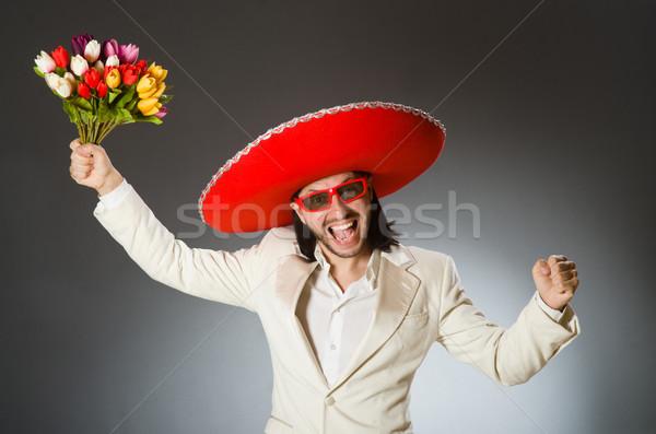 Kişi geniş kenarlı şapka şapka komik çiçekler Stok fotoğraf © Elnur