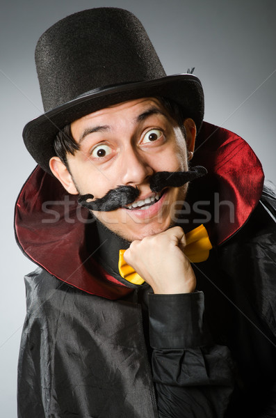 Funny magician man wearing tophat Stock photo © Elnur