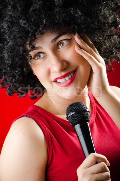 Kadın afro şarkı söyleme karaoke kız Stok fotoğraf © Elnur