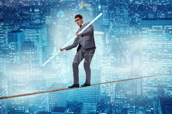 Biznesmen lina spaceru ryzyko tle budynków Zdjęcia stock © Elnur