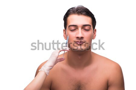 Stock photo: Naked man drinking water isolated on white