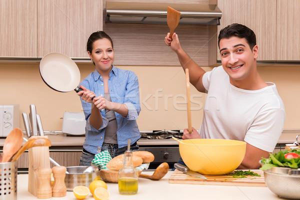 Genç aile komik kavga mutfak gıda Stok fotoğraf © Elnur