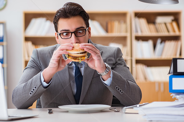 éhes vicces üzletember eszik egészségtelen étel szendvics Stock fotó © Elnur