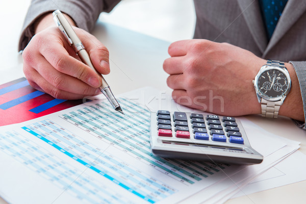 Stock photo: Finance analyst looking and financial reports