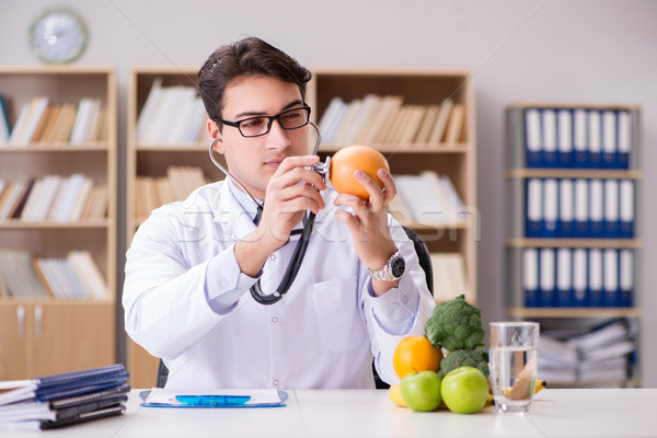 Doctor in GMO food concept Stock photo © Elnur