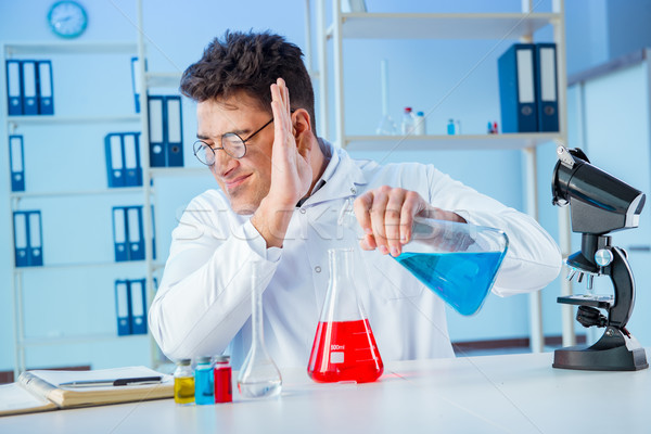 The funny mad chemist working in a laboratory Stock photo © Elnur