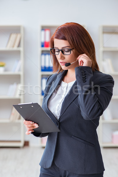 Call center operator working with clients Stock photo © Elnur