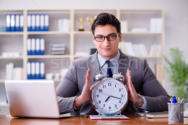 Young businessman in time management concept Stock photo © Elnur