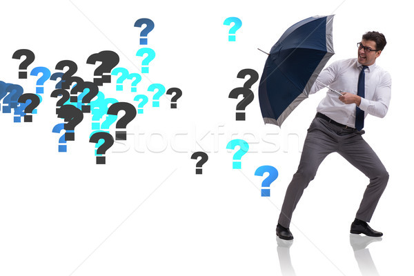 Uncertainty concept with businessman and question marks Stock photo © Elnur