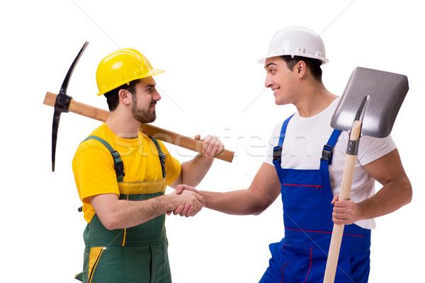 Foto stock: Dos · trabajadores · aislado · blanco · manos · trabajador