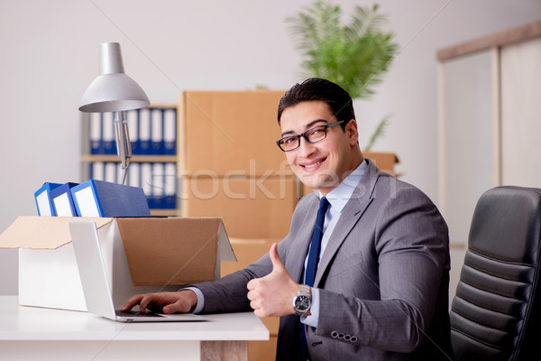 Businessman moving offices after promotion Stock photo © Elnur