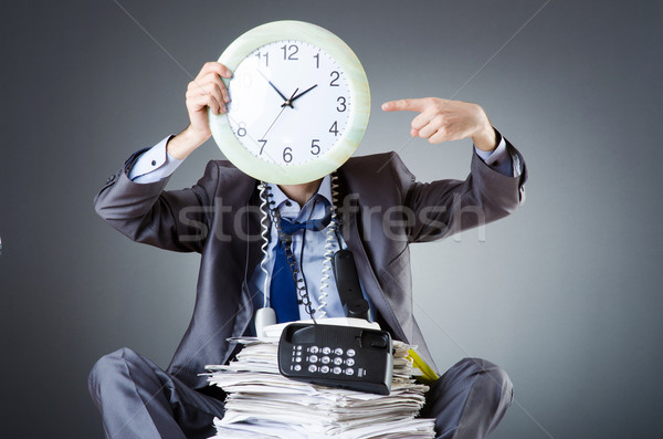 Man with clock and pile of papers Stock photo © Elnur