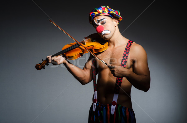 Sad clown performing at vioin Stock photo © Elnur