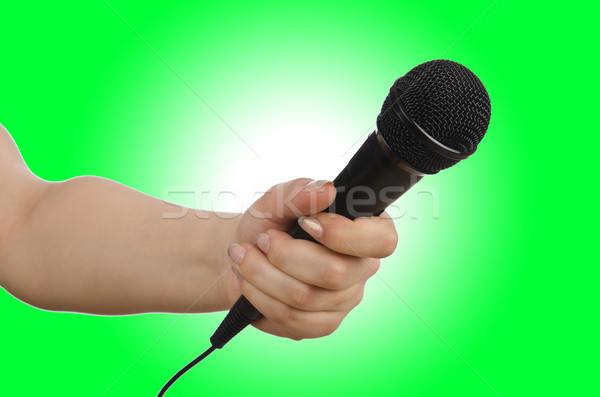 Stock photo: Hand with microphone on white