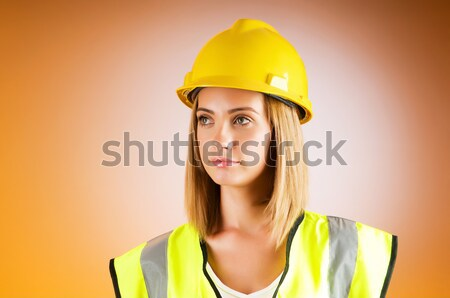 Young woman with hellow hard hat on white Stock photo © Elnur