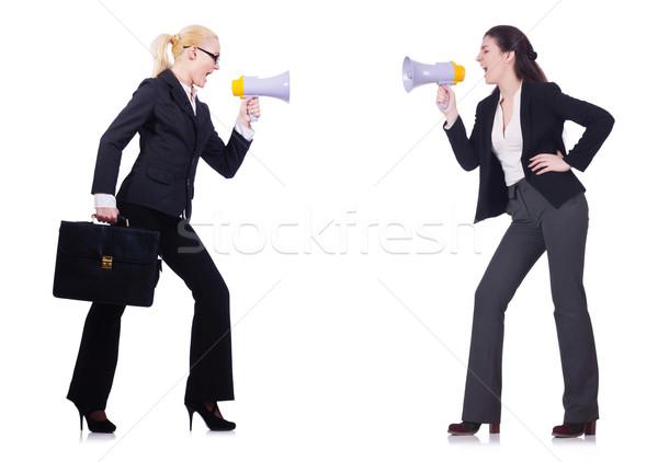 Two businesswomen holding loudpspeakers isolated on white Stock photo © Elnur