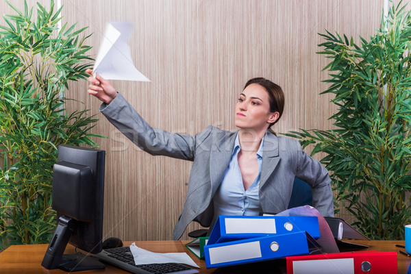 Woman throwing papers in the office under stress Stock photo © Elnur