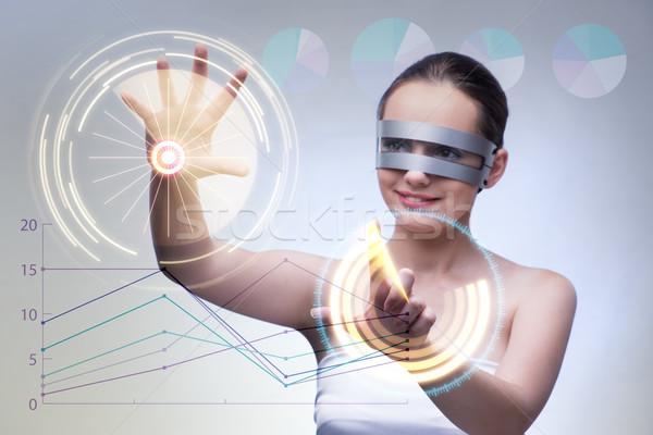 The techno businesswoman in futuristic concept Stock photo © Elnur