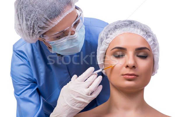 Young woman preparing for injection of botox isolated on white Stock photo © Elnur