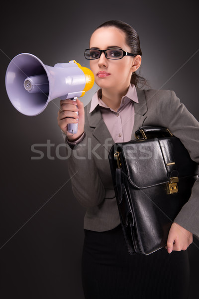 The young businesswoman with loudspeaker in business concept Stock photo © Elnur