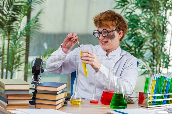 Young crazy chemist working in the lab Stock photo © Elnur