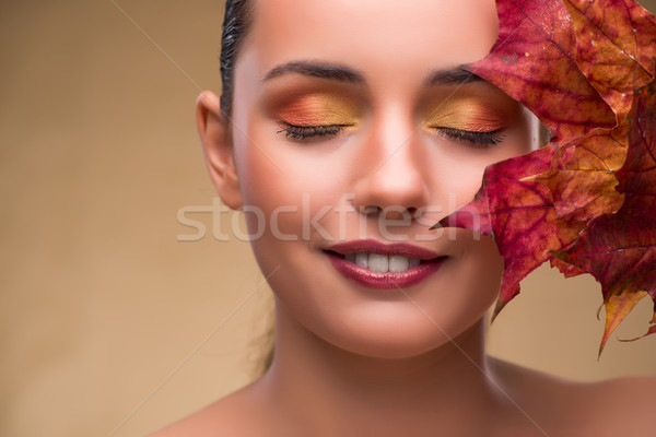 The beautiful woman in with autumn dry leaves Stock photo © Elnur