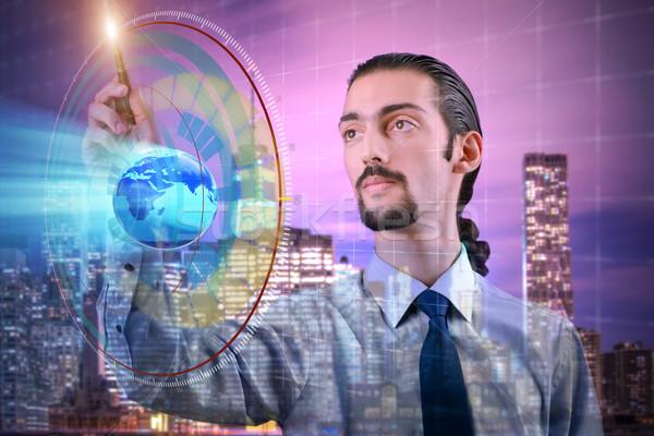 üzletember globális üzlet üzlet iroda kéz földgömb Stock fotó © Elnur