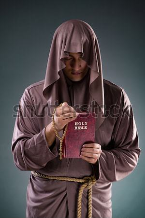 Religious nun in religion concept against dark background Stock photo © Elnur