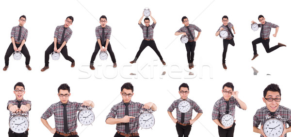 Young man with clock isolated on white Stock photo © Elnur