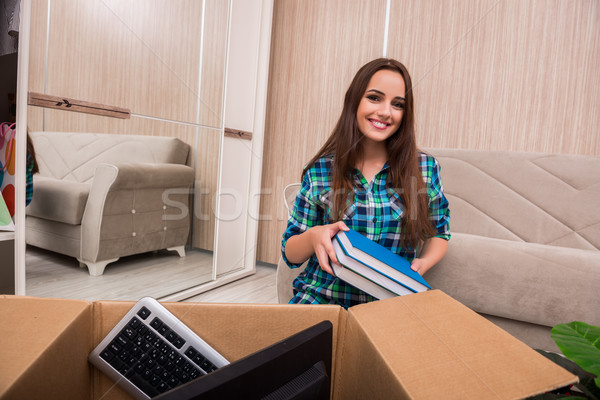 Young woman packing personal belongings Stock photo © Elnur
