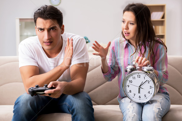 Young family suffering from computer games addiction Stock photo © Elnur
