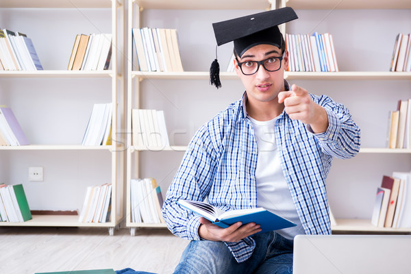 The young student studying with books Stock photo © Elnur