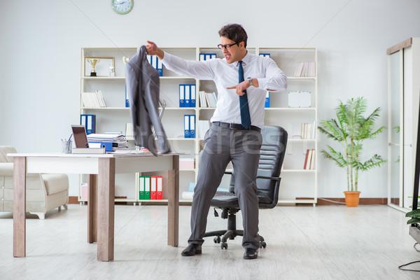 Businessman having fun taking a break in the office at work Stock photo © Elnur