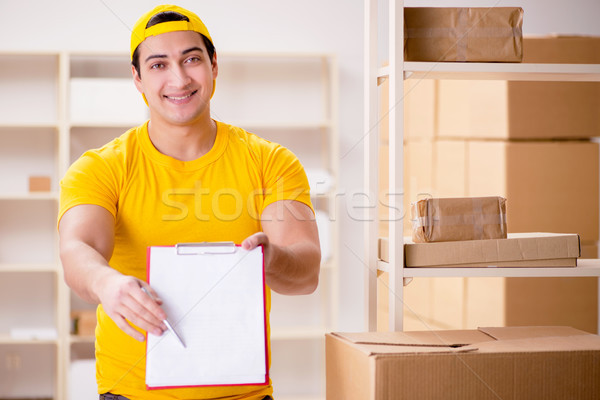 Man working in postal parcel delivery service office Stock photo © Elnur