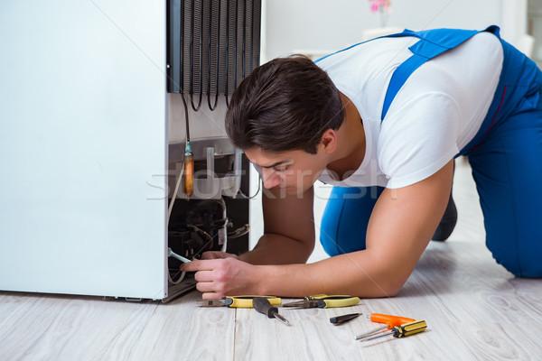 Repairman contractor repairing fridge in DIY concept Stock photo © Elnur