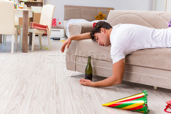 Man after heavy christmas partying at home Stock photo © Elnur