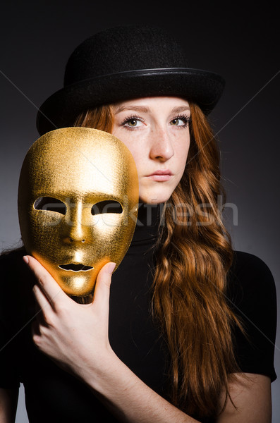 Redhead woman in hat  iwith mask in hypocrisy consept against gr Stock photo © Elnur