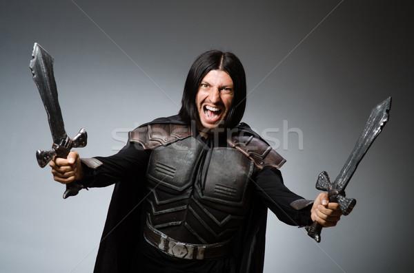 Enojado caballero espada oscuro hombre traje Foto stock © Elnur